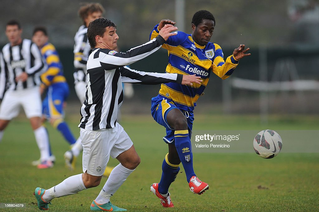 Kabashi (L) of Juventus FC competes with Sarr of FC Parma during the Juvenile match between Juventus FC and FC Parma at Juventus Center Vinovo on November 21, 2012 in Vinovo, Italy.