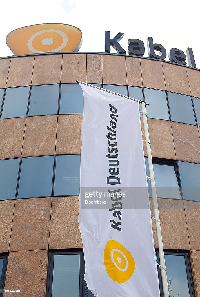 A Kabel Deutschland-branded flag flies outside the headquarters of Kabel Deutschland Holding AG, the German cable operator in Berlin, Germany, on Friday, March 1, 2013. Vodafone Group Plc has put on hold plans to approach Kabel Deutschland Holding AG about a takeover bid after leaks of a potential offer complicated internal discussions, according to three people familiar with the matter. Photographer: Krisztian Bocsi/Bloomberg via Getty Images