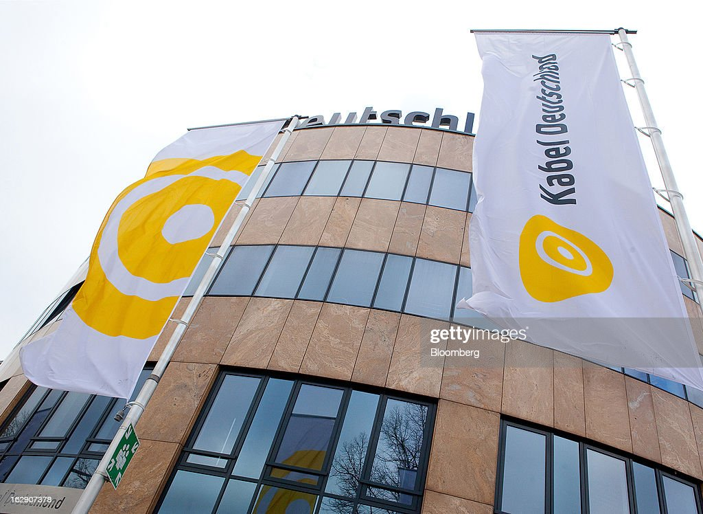 Kabel Deutschland-branded flags fly outside the headquarters of Kabel Deutschland Holding AG, the German cable operator in Berlin, Germany, on Friday, March 1, 2013. Vodafone Group Plc has put on hold plans to approach Kabel Deutschland Holding AG about a takeover bid after leaks of a potential offer complicated internal discussions, according to three people familiar with the matter. Photographer: Krisztian Bocsi/Bloomberg via Getty Images