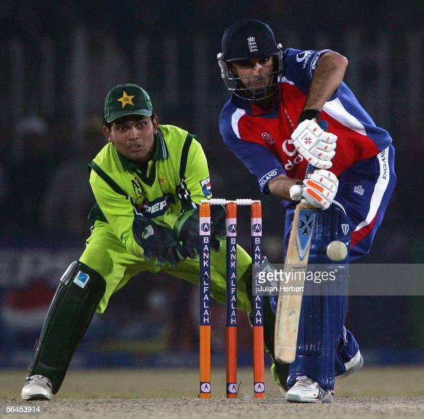 Kabir Ali of England is watched by Kamran Akmal of Pakistan as he bats during the fourth One Day International between Pakistan and England played at...