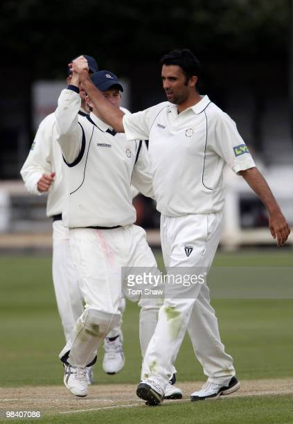 Kabir Ali of Hampshire celebrates taking the wicket of Chris Wright of Essex during the LV County Championship match between Essex and Hampshire at...