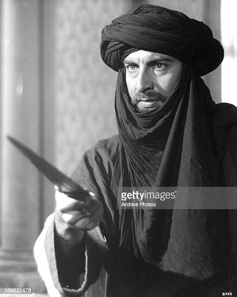 Kabir Bedi holding dagger in a scene from the film 'Ashanti' 1979
