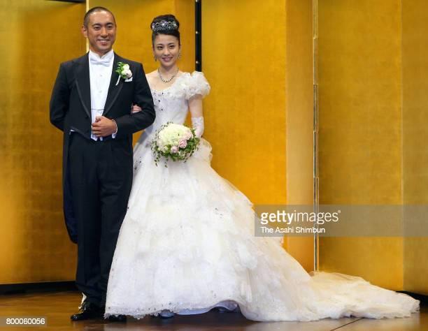 Kabuki actor Ebizo Ichikawa and former TV anchor Mao Kobayashi pose for photos at the press conference after their wedding on July 29 2010 in Tokyo...
