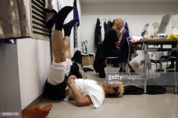 Kabuki actor Kuniya Sawamura stretches as he prepares to perform in a final dress rehearsal for the kabuki theatre show 'Hanakurabe Senbonzakura' on...