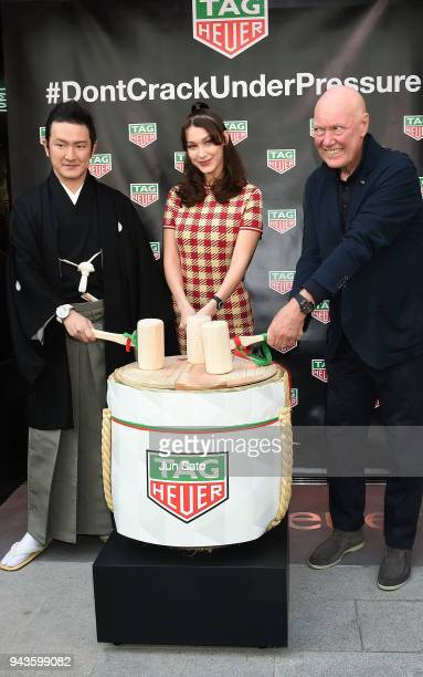 Kabuki actor Shido Nakamura Bella Hadid and Head of Watchmaking of LVMH JeanClaude Biver attend the opening ceremony for Tag Heuer Ginza Boutique on...