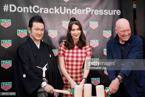 Kabuki actor Shido Nakamura Model Bella Hadid and TAG Heuer CEO JeanClaude Biver attend the TAG Heuer Ginza Boutique Opening Ceremony on April 9 2018...