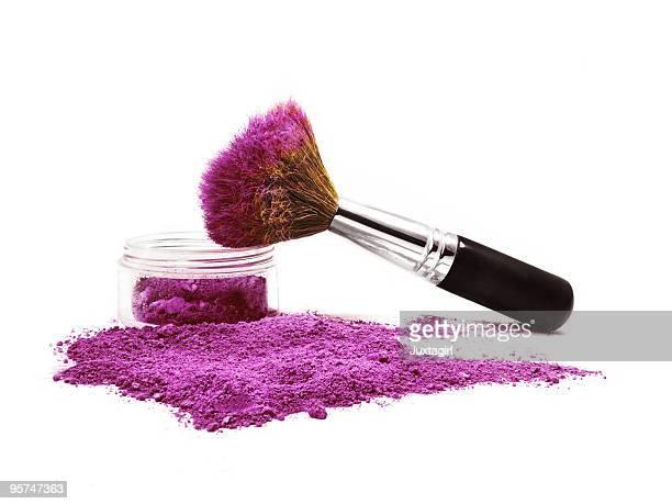 Kabuki brush balanced on mineral make-up jar Isaolated