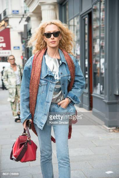Kabuki store owner and fashion buyer Elina Halimi wears a Loewe bag and Rayban sunglasses Balenciaga scarf and shop redone jeans and jacket day 1 of...