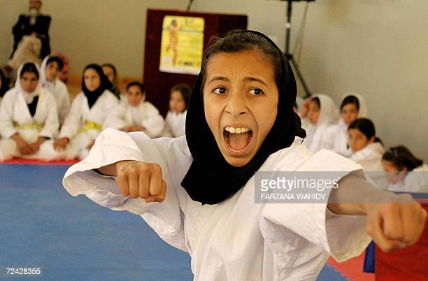 Afghan girls compete in the karate competition of a fiveday sports olympiade for women and girls organised in the capital Kabul 06 November 2006 The...