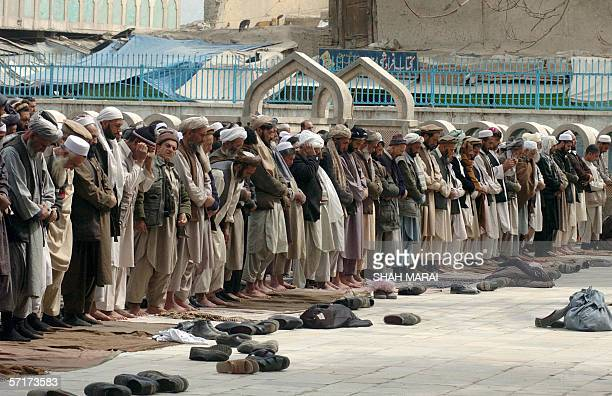 Afghan men attend the Friday prayers at the PuleKhashti Mosque in Kabul 24 March 2006 Australian Prime Minister John Howard lent his voice to growing...