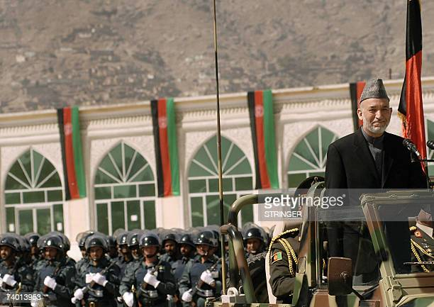 Afghan president Hamid Karzai drives by during a Mojahidin victory celebration in Kabul, 28 April 2007. Afghanistan displayed its growing military...