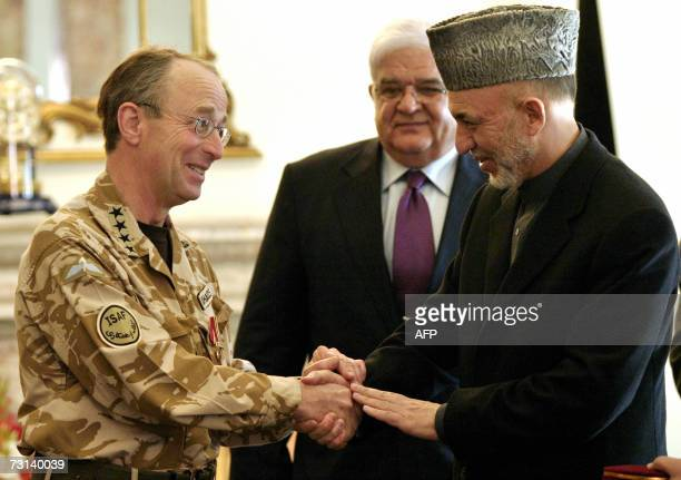 Afghan President Hamid Karzai shakes hands with Commander of NATO International Security Assistance Force British General David Richards at The...