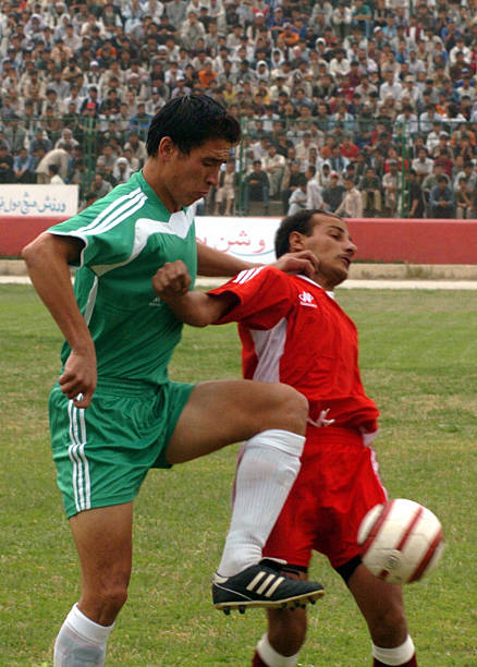 An Afghan Footballer L Tackles A Pakis