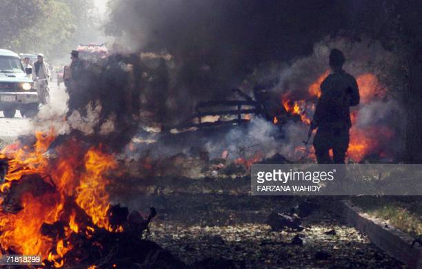 An Afghan policeman secures the site of a suicide car bomb blast, about 100 metres from the US embassy in Kabul, 08 September 2006. Two US soldiers...