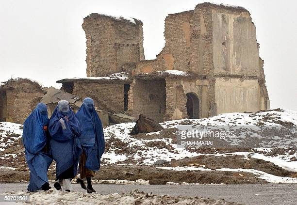 Burqa clad Afghan women walk past a destroyed building in Kabul 30 January 2006 The United States has been Afghanistan's biggest donor since leading...
