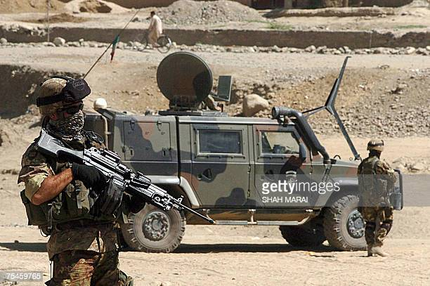 Italian soldiers with the NATOled International Security Assistance Force stand guard at the site of a suicide attack on the outskirts of Kabul 18...
