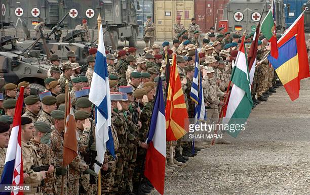 Soldiers of the International Security Assistance Force are pictured with international flags during a ceremony at the Kabul Multi-National Brigade...