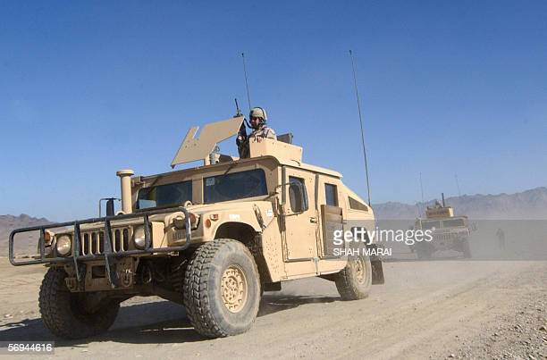 US soldiers arrive in armoured vehicles at the highsecurity PuleCharkhi Prison in Kabul27 February 2006 Police and troops sealed off a block of...