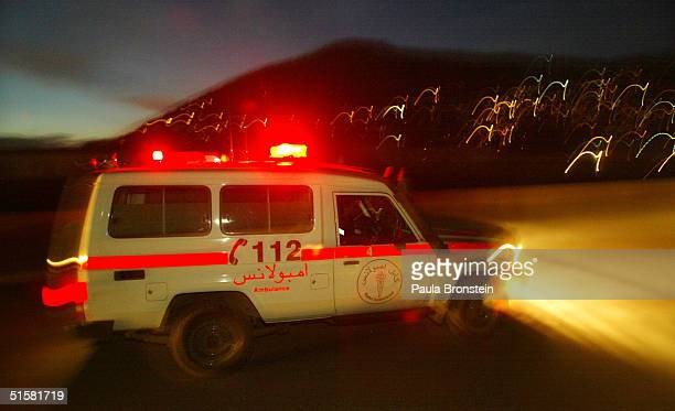 Kabul ambulance drives towards its headquarters after sunset October 27 2004 in Kabul Afghanistan The Norwegian Red Cross sponsors the Kabul...