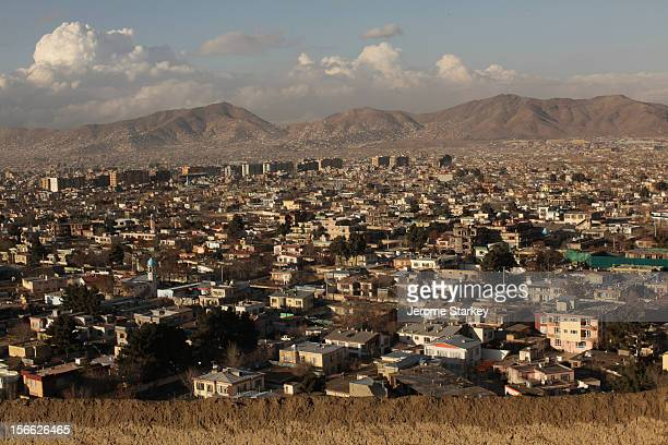 Kabul cityscape on an unusually clear day, as seen looking north from the mud-walled fort in Taimani. Days of rain cleared the dust and smog which...