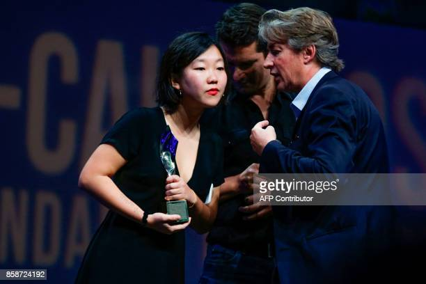"""Kabul-based journalist May Jeong receives the """"Jeune reporter Presse Ecrite"""" award for """"La mort venue du ciel"""" during the closing ceremony of the..."""