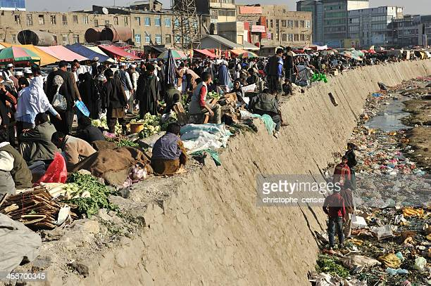 Kabul's bazaar / market along heavily polluted Kabul river