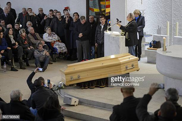 Kabyle singer Idir performs with a guitar during a ceremony to pay tribute to late Algerian opposition figure Hocine Ait-Ahmed, on December 29, 2015...