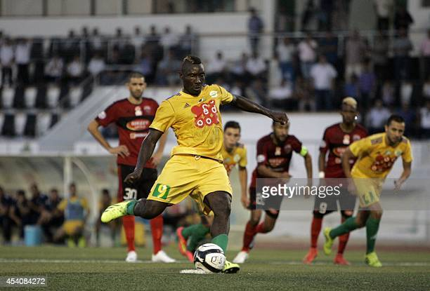 JS Kabylie's Cameroonian striker Albert Ebosse converts a penalty during his team's match with USM Alger in the city of TiziOuzou in the mainly...