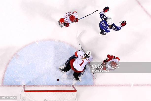 Kacey Bellamy of the United States celebrates a second period goal by Gigi Marvin against Valeria Tarakanova of Olympic Athlete from Russia during...