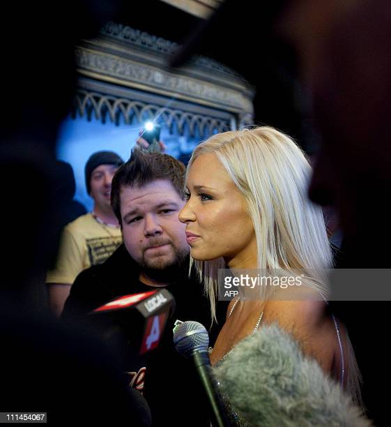 Kacey Jordan, a porn star who partied with Charlie Sheen is mobed by reporters as she arrives at the Fox Theatre in Detroit, Michigan on April 2,...