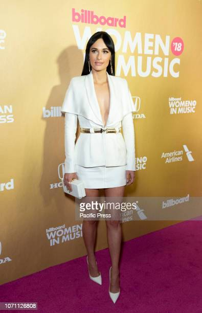 Kacey Musgrave wearing dress by Brandon Maxwell attends Billboard's 13th Annual Women in Music gala at Pier 36