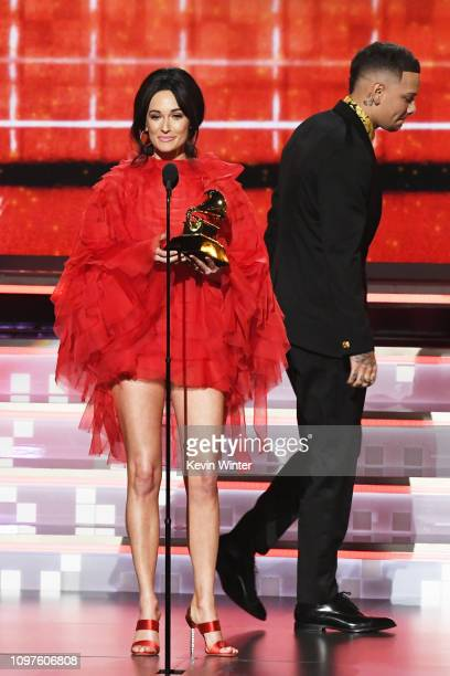 Kacey Musgraves accepts the Best Country Album award for 'Golden Hour' from Kane Brown onstage during the 61st Annual GRAMMY Awards at Staples Center...