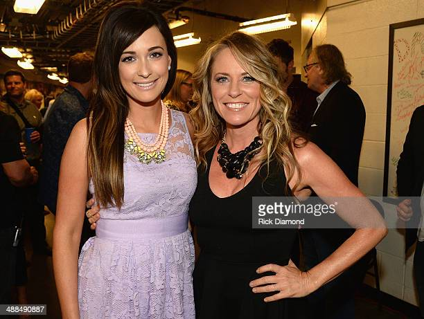 Kacey Musgraves and Deana Carter attend Keith Urban's Fifth Annual We're All 4 The Hall Benefit Concert at the Bridgestone Arena on May 6 2014 in...