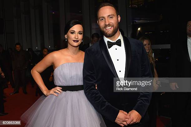 Kacey Musgraves and Ruston Kelly attend the 50th annual CMA Awards at the Bridgestone Arena on November 2 2016 in Nashville Tennessee