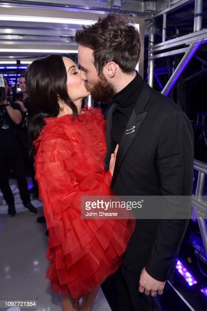 Kacey Musgraves and Ruston Kelly celebrate backstage during the 61st Annual GRAMMY Awards at Staples Center on February 10 2019 in Los Angeles...