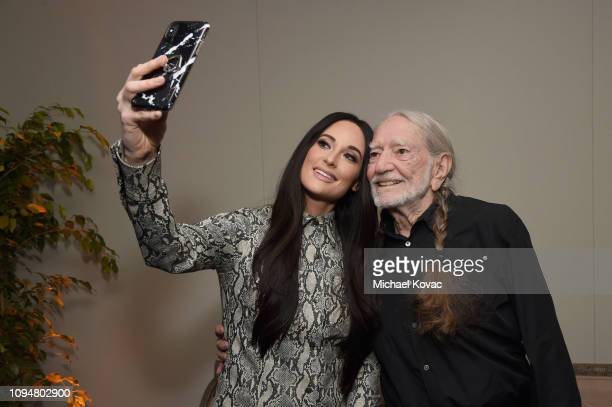 Kacey Musgraves and Willie Nelson attend the Producers Engineers Wing 12th annual GRAMMY week event honoring Willie Nelson at Village Studios on...