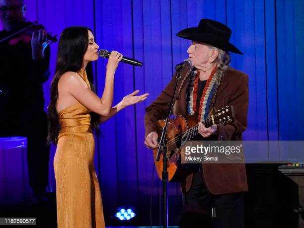 Kacey Musgraves and Willie Nelson perform onstage during the 53rd annual CMA Awards at the Bridgestone Arena on November 13 2019 in Nashville...