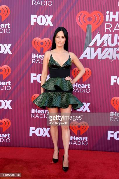 Kacey Musgraves attends the 2019 iHeartRadio Music Awards which broadcasted live on FOX at Microsoft Theater on March 14 2019 in Los Angeles...