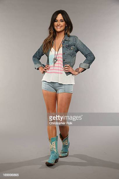 Kacey Musgraves poses at the Wonderwall portrait studio during the 2013 CMT Music Awards at Bridgestone Arena on June 5 2013 in Nashville Tennessee
