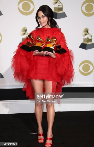 Kacey Musgraves poses in the press room with her awards for Best Country Solo Performance for 'Butterflies' Best Country Song for 'Space Cowboy' Best...