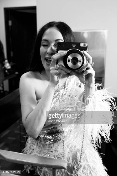 Kacey Musgraves poses with a camera backstage during the 53rd Annual CMA Awards during the at Bridgestone Arena on November 13 2019 in Nashville...