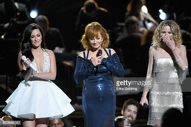 Kacey Musgraves Reba McEntire and Jennifer Nettles perform for Dolly Parton onstage at the 50th annual CMA Awards at the Bridgestone Arena on...