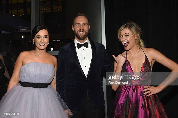 Kacey Musgraves Ruston Kelly and Kelsea Ballerini attend the 50th annual CMA Awards at the Bridgestone Arena on November 2 2016 in Nashville Tennessee