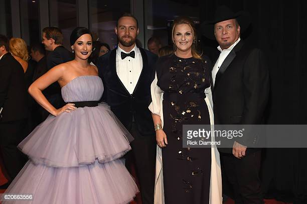 Kacey Musgraves Ruston Kelly and Trisha Yearwood and Garth Brooks attend the 50th annual CMA Awards at the Bridgestone Arena on November 2 2016 in...