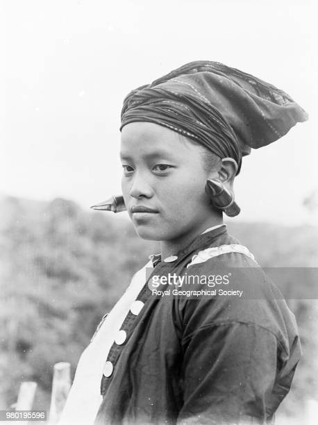 Kachin woman in her gala dress Accompanying caption 'Kachins or Chingpaw and Maru of Burma Another Kachin woman in her gala dress The ear lobes are...