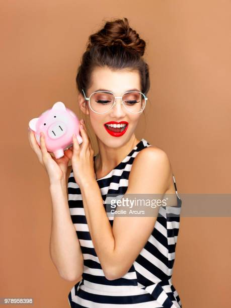 ka-ching! - one young woman only stock pictures, royalty-free photos & images