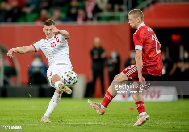 Kacper Kozlowski of Poland in action with Maksim Mukhin of Russia during the international friendly match between Poland and Russia at the Municipal...