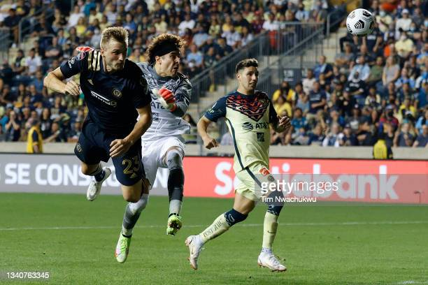 Kacper Przybyłko of Philadelphia Union attempts a header past Guillermo Ochoa of Club America during the second half during the semifinal second leg...