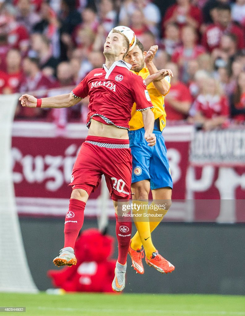 Kacper Przybylko (1. FC Kaiserslautern) (l) challenges Ken Reichel (Eintracht Braunschweig) (r) during the 2. Bundesliga match between 1. FC Kaiserslautern and Eintracht Braunschweig at Fritz-Walter-Stadion on July 31, 2015 in Kaiserslautern, Germany.
