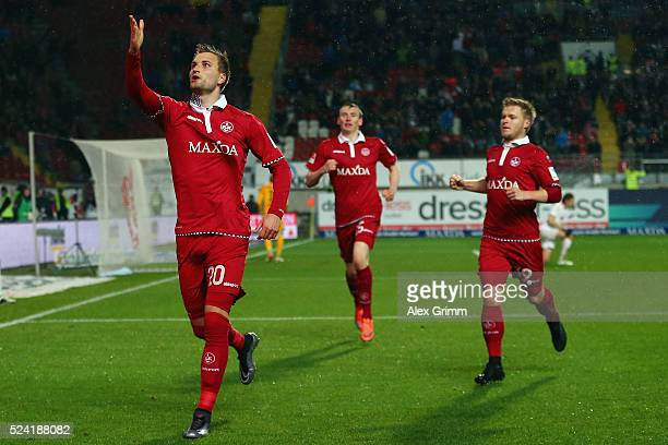 Kacper Przybylko of Kaiserslautern celebrates his team's first goal with team mates Jean Zimmer and Jon Dadi Bodvarsson during the Second Bundesliga...